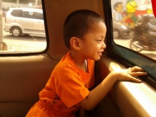 a boy sitting in a car