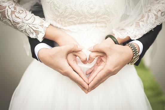 couple-make-a-heart-sign